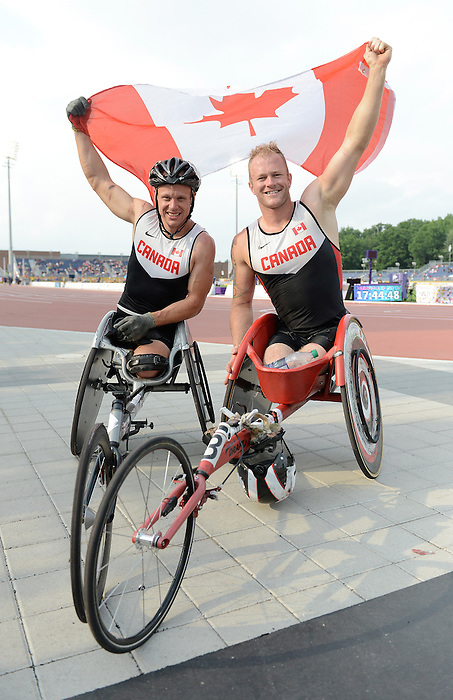 Toronto, ON - Aug 14 2015 - Alex Dupont and Joshua Cassidy after winning gold and silver in the Men's 1500m T54 Final in the CIBC Athletics Stadium during the Toronto 2015 Parapan American Games  (Photo: Matthew Murnaghan/Canadian Paralympic Committee)