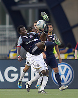 New England Revolution forward Kenny Mansally (7) attempts a bicycle kick. In a Major League Soccer (MLS) match, the Philadelphia Union defeated the New England Revolution, 3-0, at Gillette Stadium on July 17, 2011.