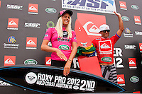 SNAPPER ROCKS, Queensland/Australia (Sunday, March 4, 2012)Laura Enever (AUS) and Adriano de Souza (BRA).  The final day of the Quiksilver and Roxy Pro Gold Coast presented by Land Rover culminated today with perennial ASP World Title threat Taj Burrow (AUS), 33, and four-time ASP Womens World Champion Stephanie Gilmore (AUS), 24, taking the respective wins in clean two-to-three foot (1 metre) waves at the primary venue of Snapper Rocks.. .The opening stop on the 2012 ASP World Championship Tour, the Quiksilver and Roxy Pro Gold Coast enjoyed sunny weather, light winds and a capacity crowd for the final day of competition, with the worlds best surfers putting on a spectacular display of high-performance surfing.. .Burrow defeated dangerous South American Adriano De Souza (BRA), 25, in a Final that came down to the wire. De Souza caught a wave in the dying minutes and launched into a massive air-reverse, requiring a 7.87 out of a possible 10 to take the lead. The judges deliberated until after the siren sounded and when it was announced that De Souza came a mere 0.27 short, Burrow was chaired up the beach and declared the 2012 Quiksilver Pro Gold Coast champion..Stephanie Gilmore (AUS), 24, reigning four-time ASP Womens World Champion, her fourth Roxy Pro Gold Coast title after defeating ASP Top 17 sophomore Laura Enever (AUS), 20, in a hard-fought Final. Gilmore was dominant throughout the event, posting scores in the excellent range in every encounter throughout the draw. Gilmore jumps back to No. 1 on the ASP Womens World Championship Tour ratings, a spot she lost at this event last year after holding it for four years.. Photo: joliphotos.com