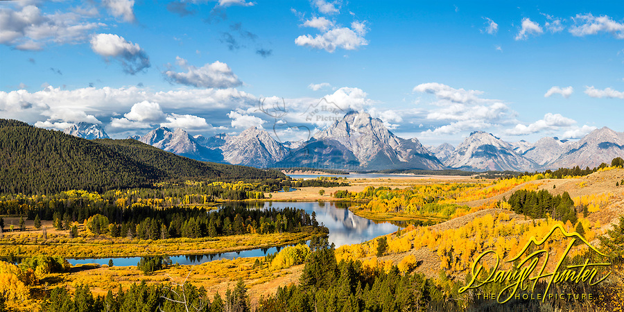 The famous Oxbow Bend of the Snake River from above. Autumn is an amazing time to photograph the splendor of the golden aspen that sprout prodigiously around the river. The traditional place to shoot the Oxbow is along the river, this mountain above provides a fresh angle on this iconic spot.<br />