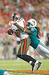 Tampa Bay Buccaneers wide receiver Aundrae Allison (4) is hit by Miami Dolphins safety Chris Clemons (30). The Buccaneers defeated the Dolphins 17-13 in an NFL preseason game Saturday, August 27, 2011 in Tampa, Fla.  (AP Photo/Margaret Bowles)