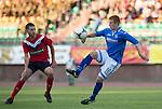 St Johnstone v FC Minsk...01.08.13 Europa League Qualifier at Neman Stadium, Grodno, Belarus...<br /> Liam Caddis and Dimitry Gorbushin<br /> Picture by Graeme Hart.<br /> Copyright Perthshire Picture Agency<br /> Tel: 01738 623350  Mobile: 07990 594431
