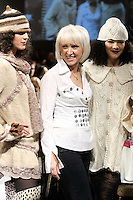 Fashion designer  Janina Stankiene, poses with models at the close of her Janerations Fall 2012 collection fashion show, during Couture Fashion Week New York Fall 2012.