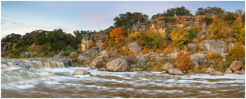 With colors of Autumn above it, the raging Pedernales River overflows through a small canyon in Pedernales Falls State Park. Heavy rains had blanketed the area in previous days, causing the river to rise to an epic level. Contrasted with the reds and golds of fall, I was happy to be a part of this Texas Hill Country scene.
