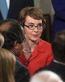 United States Representative Gabrielle Giffords (Democrat of Arizona) arrives U.S. House Chamber prior to U.S. President Barack Obama delivering the State of the Union Address in the U.S. Capitol in Washington, D.C. on Tuesday, January 24, 2012..Credit: Ron Sachs / CNP.(RESTRICTION: NO New York or New Jersey Newspapers or newspapers within a 75 mile radius of New York City)