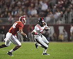 Ole Miss's Ja-Mes Logan (85) is tackled by Alabama defensive back Robert Lester (37) and Alabama defensive back DeQuan Menzie (24) at Bryant-Denny Stadium in Tuscaloosa, Ala.  on Saturday, October 16, 2010. Alabama won 23-10.