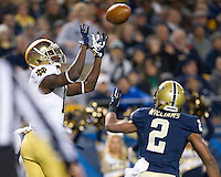DaVaris Daniels (10) catches a pass for a touchdown as Pittsburgh Panthers defensive back K'waun Williams (2) defends in the first quarter.