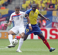 Costa Rica's Alvador Saborio (19) and Ecuador's Giovanny Espinoza (17) battle for the ball in Hamburg, Germany, Thursday, June 15, 2006.