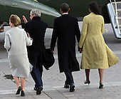 Washington, DC - January 20, 2009 -- Former United States President George W. Bush, his wife Laura, United States President Barack Obama and his wife, first lady Michelle Obama, walk out of the East Front of the Capitol after the inauguration of Obama as the 44th President of the United States of America on the West Front of the Capitol, Tuesday, January 20, 2009 in Washington, DC. Obama becomes the first African-American to be elected to the office of President in the history of the United States. .Credit: John Moore / Pool via CNP