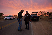Three Points, Arizona.USA.October 23, 2006..Arizona resident David Jones (handle- Pineapple6,) and Neil Webdting of Nevada are members of the Minuteman Civil Defense Corps of Arizona. Near the King Anvil Ranch they detains four Mexicans who have crossed the border illegal. They give the four water and hold until the Arizona border patrol arrives to detain them and send them back to Mexico....