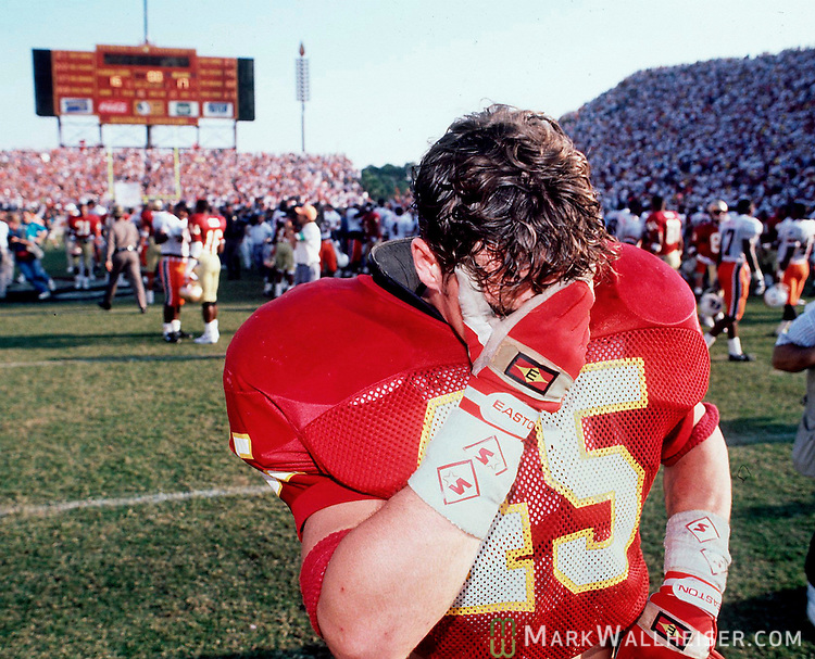 """FSU's linebacker Kirk Carruthers leaves the field after FSU's dissapointing 16-17 loss to Miami in the """"wide right"""" game at Doak Campbell on Nov. 16, 1991."""