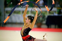 Monica Mincheva of Bulgaria pivots and makes waves with ribbon at 2006 Trofeo Cariprato in Prato, Italy on June 17, 2006.  (Photo by Tom Theobald)