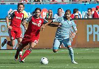 18 August 2012: Sporting KC midfielder Paulo Nagamura #6 and Toronto FC midfielder Torsten Frings #22 in action during an MLS game between Sporting Kansas City and Toronto FC at BMO Field in Toronto, Ontario Canada.