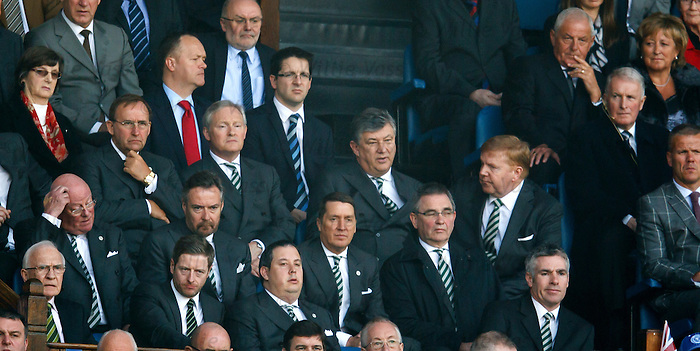 Celtic secuity chief Ronnie Hawthorn walks down the Rangers directors box at the start of the second half to speak to chief executive Peter Lawwell after manager Neil Lennon was told to sit in the stand by ref Calum Murray
