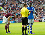 Hearts v St Johnstone...04.08.12.Gregory Tade appeals to ref Stevie O'Reilly before being sent off.Picture by Graeme Hart..Copyright Perthshire Picture Agency.Tel: 01738 623350  Mobile: 07990 594431