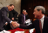 Washington, D.C. - April 14, 2004 --  Robert S. Mueller, III, Director, Federal Bureau of Investigation (FBI), right, shakes hands with Thomas Kean, Chairman, National Commission on Terrorist Attacks (9-11 Commission) following his testimony in Washington, DC on April 14, 2004.<br /> Credit: Ron Sachs / CNP<br /> [RESTRICTION: No New York Metro or other Newspapers within a 75 mile radius of New York City]