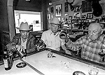 Oakdale, California 1985&mdash;Liar&rsquo;s Dice&mdash;The Bacigalupi family has owned H-B Saloon since 1953.  At the bar playing liar&rsquo;s dice are Frankie Martin, Bill Rodden, and Grand Pa David Bacigalupi.<br /> <br /> Photo by Al Golub/Golub Photography