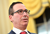 Steven Munchin is seen as he is sworn-in as United States Treasury Secretary during a ceremony at the White House in Washington, D.C. on February 13, 2017. Mnuchin was confirmed by the Senate 54-47 earlier today. <br /> Credit: Kevin Dietsch / Pool via CNP