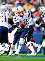 20 December 2009: New England Patriots' quarterback Tom Brady makes a handoff in second quarter action against the Buffalo Bills at Ralph Wilson Stadium in Orchard Park, New York. The Patriots defeated the Bills 17-10. Mandatory Credit: Ed Wolfstein Photo