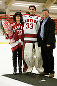 Kyle Richter (Harvard - 33) with his parents - The Harvard University Crimson defeated the St. Lawrence University Saints 4-3 on senior night Saturday, February 26, 2011, at Bright Hockey Center in Cambridge, Massachusetts.