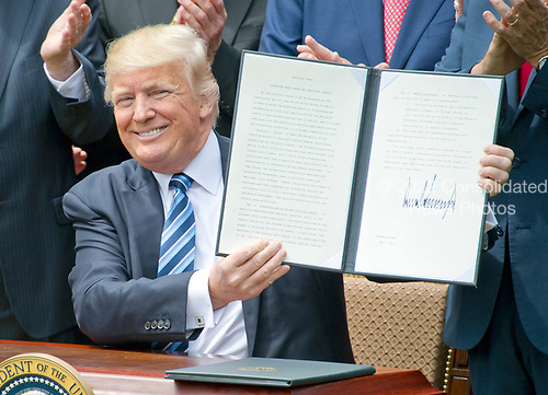 United States President Donald J. Trump signs an Executive Order &quot;Promoting Free Speech and Religious Liberty&quot; in the Rose Garden of the White House in Washington, DC on Thursday, May 4, 2017.<br /> Credit: Ron Sachs / CNP