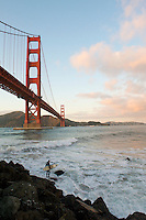 Surfer Under Golden Gate Bridge at Fort Point - San Francisco - California