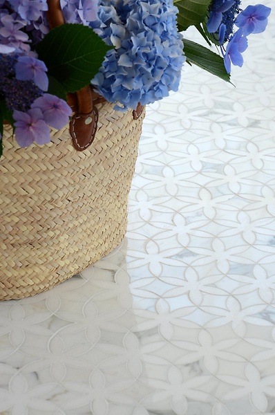 Fiona, a stone waterjet mosaic shown in Thassos and Calacatta Tia polished, is part of the Silk Road Collection by Sara Baldwin for New Ravenna Mosaics.