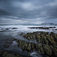 Stormy winter sky over rocky coastline of Austvågøy, Lofoten Islands, Norway