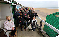 BNPS.co.uk (01202 558833)<br /> Pic: RichardCrease/BNPS<br /> <br /> The angry group of beach hut owners whose stunning views are shortly to be ruined.<br /> <br /> Beach hut owners fury after sea views are blocked...by more beach huts.<br /> <br /> Irate beach hut owners have slammed a council who have allowing a row of beach huts to be built directly in front of them blocking their beautiful sea views.<br /> <br /> Owners who pay &pound;1,094 a year to the council to have a beach hut there will instead have to make do with the view of the back of another beach hut.<br /> <br /> Furious owners in the Manor Steps area in Bournemouth, Dorset, are demanding action after being told of plans to place more huts between them and the beach by the end of the month.<br /> <br /> They claim their views of the sea, beach and prom will be completely blocked and that the council has not consulted them on the plans.<br /> <br /> Bournemouth Borough Council said the move is necessary to allow for the creation of a turning circle for the newly-routed land train.<br /> <br /> Mrs Vincent, who has owned a beach hut for more than 50 years, said: &quot;What's the point of owning a beach hut if all you can see is the back of another hut?