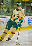 14 December 2013: University of Vermont Catamount Defenseman Nick Luukko, a Junior from West Chester, PA, controls the puck during the third period against the Saint Lawrence University Saints at Gutterson Fieldhouse in Burlington, Vermont. The Catamounts defeated their former ECAC rivals, 5-1 to notch their 5th straight win in NCAA non-divisional play. Mandatory Credit: Ed Wolfstein Photo *** RAW (NEF) Image File Available ***