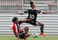 BOYDS, MARYLAND - July 21, 2012:  Lianne Sanderson (10) of DC United Women is fouled by Stephanie Goddard (21) of the Virginia Beach Piranhas during a W League Eastern Conference Championship semi final match at Maryland Soccerplex, in Boyds, Maryland on July 21. DC United Women won 3-0.