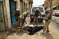 """Baghdad, Iraq, June 2, 2003.US troops often completely misunderstand perfectly benign circumstances for lack of translators and proper training, creating potentially dangerous situations for the Iraqi population they are supposed to protect. Here, a couple of gunshots were fired in the air at the end of a wedding as is customary, US troops parolling the area blocked up a street and tried to break into a house where they wrongly thought the """"shooter"""" had taken refuge, the 2 men being arrested and quite brutally treated, were in fact the owners of the house who keenly offered to open it to prove it was empty..."""
