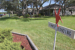Sign in front of a house designating this house as a stop on the home tour in Rockport Texas during the Hummer/Bird Celebration