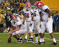Youngstown State offensive guard Chris Elkins (66), center Mark Pratt (76), guard Lamar Mady (55) and tackle Kyle Bryant (71) get ready for the snap. The Youngstown St. Penguins defeated the Pittsburgh Panthers 31-17 on Saturday, September 1, 2012 at Heinz Field in Pittsburgh, PA.
