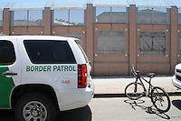 Nogales, Arizona - A Border Patrol vehicle parked next to the international U.S.-Mexico border. The vehicle was part of a caravan that took journalists to the border in an event sponsored by the U.S. Customs and Border Protection agency. This area is near the Border Patrol Nogales station, one of eight in the Tucson Sector, which is the busiest on the U.S.-Mexico border for illegal immigration, drug smuggling and border deaths. Photo by Eduardo © 2012