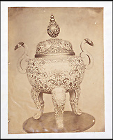 BNPS.co.uk (01202 558833)<br /> Pic: Reeman&amp;Dansie/BNPS<br /> <br /> Rare photos showing some of the precious antiques looted from China's Summer Palace 156 years ago which Asian millionaires are today buying back in their droves have come to light.<br /> <br /> The images, taken by celebrated photographer Felice Beato soon after the theft, depict Ming vases, pots and bowls made for the Chinese emperor to display at the Imperial palace in Peking.<br /> <br /> The mystical building was partially destroyed by the British and French and its wealth of contents seized and taken to Europe at the end of the Second Chinese Opium War in 1860.<br /> <br /> The beautiful pieces of porcelain are the very objects the newly-rich Chinese are paying British auction houses millions of pounds for now as they attempt to buy back their lost heritage.