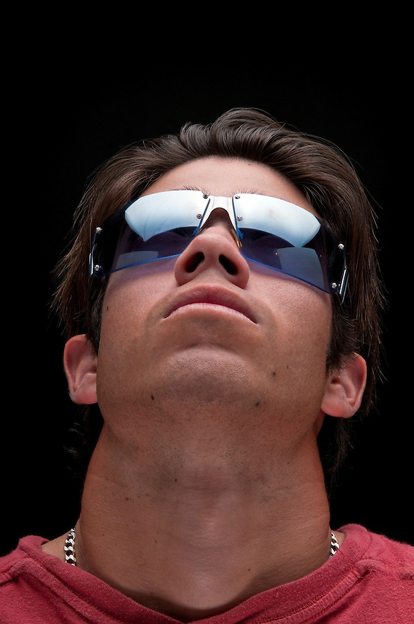 Portrait man looking up with trendy sunglasses.