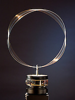 STANDING WAVE ON CIRCULAR HOOP<br /> (Variations Available)<br /> Analog - de Broglie Wavelengths &amp; Bohr Orbits<br /> A circular hoop of wire is vibrated at a variable frequency. At a frequency of 89 Hz the standing wave is visible on the wire- analagous  to the de Broglie formula for the electron orbital and showing the wave-particle duality of matter.