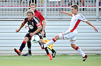 Nick DeLeon (18) of D.C. United goes against Scott Caldwell (6) of the New England Revolution. D.C. United defeated the The New England Revolution 3-1 in the Quarterfinals of Lamar Hunt U.S. Open Cup, at the Maryland SoccerPlex, Tuesday June 26 , 2013.