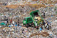 Men, women and children scavenging for plastic and metals on a rubbish dump, Freetown, Sierra Leone. Planting Promise is an organization dedicated to the development of education in Sierra Leone. Its aim is to bring opportunities to initiate self-run, self-supporting projects that offer real solutions to the difficulties facing the world's poorest country. They believe real and lasting development comes from below, from local projects that address specific needs, rather than large international models. To this end, they currently run five projects that aim to bring wealth into the country through business. The profits from these businesses are then used to support free education for children and adults...Through the combination of business with social progress, the charity hopes that they are providing real, lasting and profound changes for the better, by promoting sustainable and beneficial industry in the country, and putting it to the service to the needs of the people. As well as providing the income to fund the school, the farms will also be an example of successful commercial enterprise to teach the children in the school the viability of profit-making schemes that go beyond subsistence models, the only things the children of these desperately poor areas are accustomed to. By learning particular details of the challenges that they will face, the children will emerge from this school equipped to contribute in a real way to their society.