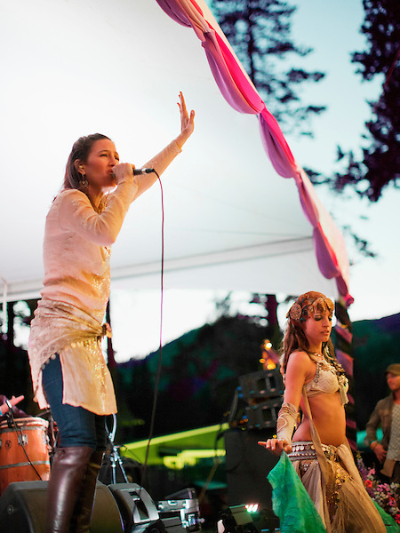 Singer, songwriter and producer Donna De Lory performs along side a belly dancer at  Wanderlust Festival..Wanderlust Festival is a yoga and music festival held annually in Squaw Valley California.