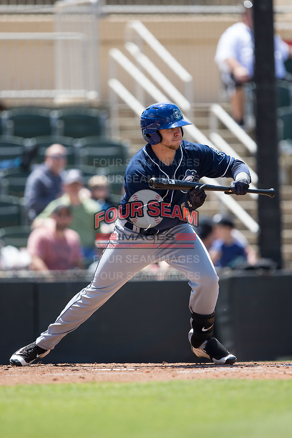 Cole Anderson (16) of the Asheville Tourists squares to bunt against the Kannapolis Intimidators at Kannapolis Intimidators Stadium on May 7, 2017 in Kannapolis, North Carolina.  The Tourists defeated the Intimidators 4-1.  (Brian Westerholt/Four Seam Images)