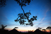 Dusk falls in the remote village of Pania where Doctor Richard Hardi and his medical team will perform eye surgery. <br /> <br /> From his base in Mbuji Mayi Hungarian ophthalmologist Friar Richard Hardi and his team travelled deep into the Congolese rainforest, by 4x4 and canoe, to treat people in isolated communities most of whom have never seen an ophthalmologist. At a small village called Pania they established a temporary field hospital and over the next three days made hundreds of consultations. Although both conditions are preventable, many of the patients they saw had Glaucoma or River Blindness (onchocerciasis) that had permanently damaged their eyesight. However, patients with cataracts, a clouding of the eye's lens, who were suitable for treatment were booked for an operation. For two days the team carried out the ten minute procedure on one patient after another. The surgery involves making a 2.2mm incision into the remove the damaged lens that is then replaced by an artificial one. Doctor Hardi is one of the few people willing to make such a journey but is inspired to do so by his faith and, as he says: 'Here I feel that I can really make a difference in people's lives'. /Felix Features