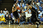 20 January 2016: Wake Forest's Devin Thomas (2) passes to Rondale Watson (right). The University of North Carolina Tar Heels hosted the Wake Forest University Demon Deacons at the Dean E. Smith Center in Chapel Hill, North Carolina in a 2015-16 NCAA Division I Men's Basketball game. UNC won the game 83-68.
