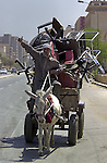 An Iraqi man in a donkey cart drives home with a load of looted furniture April 11, 2003 in Baghdad, Iraq. Widespread looting of both government buildings and private businesses was rampant across Baghdad following the collapse of local authority after coalition forces took the city.