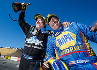 Jul 31, 2016; Sonoma, CA, USA; NHRA funny car driver John Force (left) celebrates after defeating Ron Capps to win the Sonoma Nationals at Sonoma Raceway. Mandatory Credit: Mark J. Rebilas-USA TODAY Sports
