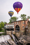 Hot air balloons float above the Ottaquechee River Dam at the Quechee Balloon Fest in Quechee, VT
