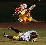 Palm Desert High School's William Fisher gets hit deep in the endzone by Barstow High School's Curtis Webb during first quarter game action at Palm Desert High School on Friday, November 17, 2006. Fisher broke his leg on the play and left the game. His season was finished and Webb was ejected from the game for unsportsman-like conduct.