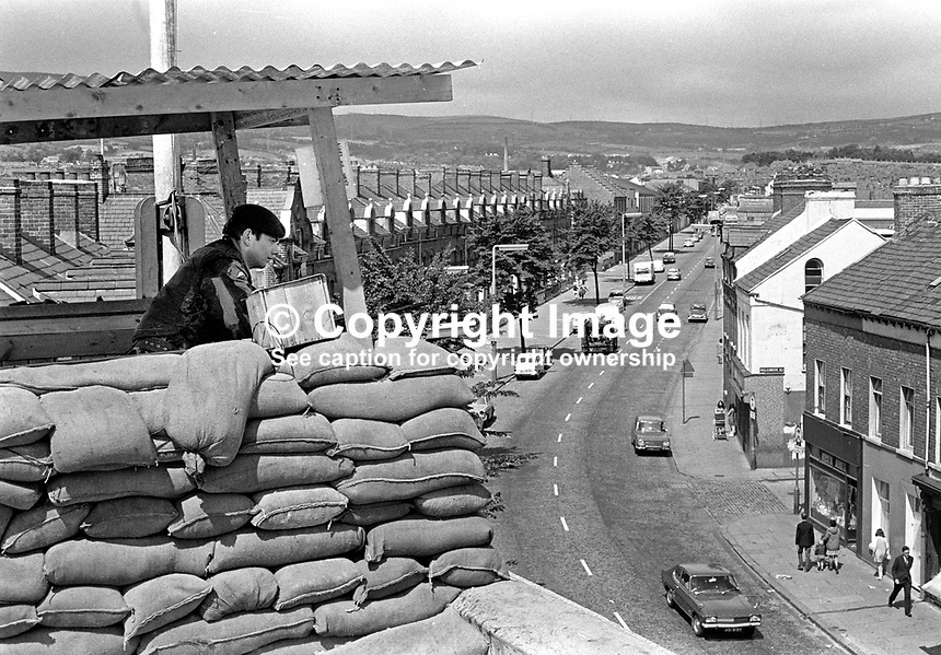 Soldier from Second Parachute Regiment on duty in look-out on top of Springfield Road Police Station, Belfast, N Ireland, UK. Ref: 19710715001.<br /> <br /> Copyright Image from Victor Patterson, 54 Dorchester Park, Belfast, UK, BT9 6RJ<br /> <br /> t1: +44 28 9066 1296 (from Rep of Ireland 048 9066 1296)<br /> t2: +44 28 9002 2446 (from Rep of Ireland 048 9002 2446)<br /> m: +44 7802 353836<br /> <br /> e1: victorpatterson@me.com<br /> e2: victorpatterson@gmail.com<br /> <br /> www.victorpatterson.com<br /> <br /> IMPORTANT: Please see my Terms and Conditions of Use at www.victorpatterson.com
