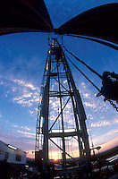 Sunrise shot of oil drilling rig, fisheye view